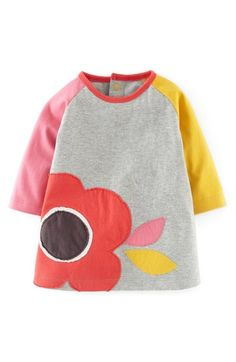Free shipping and returns on Mini Boden Fun Colorblock Appliqué Dress (Baby Girls) at Nordstrom.com. A floral appliqué blooms on a charming dress with color-blocked raglan sleeves.