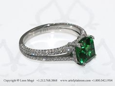 Split shank solitaire ring, featuring 2.39 carat cushion green tsavorite.