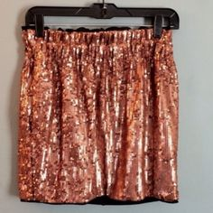 Rose gold sequin skirt Worn once. In like new condition. Elastic waistband. Size xs. In my opinion this skirt runs big and could fit a small and possibly a medium. Rachel by Rachel Roy. RACHEL Rachel Roy Skirts