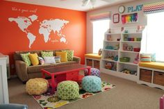 A colorful kids playroom with pouf seating and a map mural wall