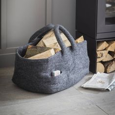 Beautifully handmade and 100% Fairtrade. Using only natural dyes. Prices from £30Southwold Basket with Wooden Handles £75.00 Southwold Basket with Star £30 Southwold Basket in Dark Grey £75The ample internal space is particularly suited to storing logs beside the fire but is also ideal to keeping children's toys at bay or piling with blankets.Crafted in Felt - 100% Sheep WoolItem is Fair Trade and handmade in Nepal Uses Azo free dyes Handwash in cold or warm water Do not tumble dry Due to… Pouf Design, Log Carrier, Bamboo Sofa, Rectangular Baskets, Jute Bags, Stoneware Mugs, Sheep Wool, Organic Shapes, Wooden Handles
