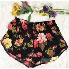 "SALE 59% OFF  Black Floral Running Shorts Perfect pair of lightweight shorts for the summer. Black with a sweet rose flower pattern. Made of 100% polyester. Waist measures 24"" with 4.5"" of stretch. Length  11"" These also come is Medium and Large. Naturally Spiritual Boutique Shorts"