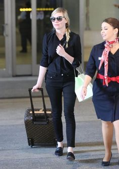 """Kirsten Dunst proving that the """"all black"""" travel uniform always looks chic!"""