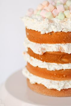 Ambrosia Cake -- layers of white cake with fluffy coconut, mandarin orange, and pineapple filling.