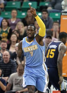 Denver Nuggets J.J. Hickson (7) celebrates after scoring against the Utah Jazz in the fourth quarter during an NBA basketball game Monday, Nov. 11, 2013, in Salt Lake City. Denver Nuggets won 100-81. (AP Photo/Rick Bowmer)