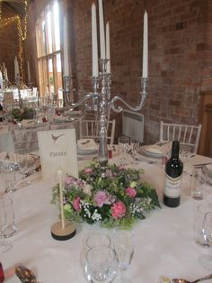 Candelabra available for hire with a ring of flowers at the base