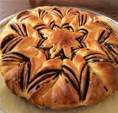 How to Make Braided Nutella Star Bread       450 g (3½ cups) of flour plus around 50 g ( ⅜ cup) for sprinkling     180 ml (¾ cup) of milk     2 egg yolks (use egg whites for brushing the bread)     8 g (1 ½ tsp) of active dry yeast     30 g (2 tbsp) of butter     70 g (⅓ cup) of sugar     pinch of salt     200 g (around 1 cup) of chocolate spread