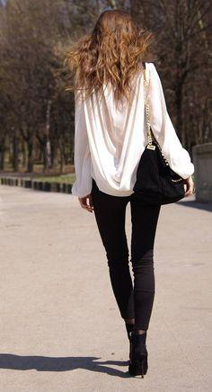 Black skinny jeans with white flowy blouse. #streetstyle #blackandwhite
