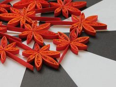 Maple Leaves Red Orange, Quilled Handmade Art, Paper Quilling, Home Fall Decoration Idea, Confetti, Scrapbooking, 10 pcs. Can be used as dinner table confetti decorations, scrapbook embellishments, ornamental additions to gifts, hanging decor, fridge magnet and many more! This listing is for 10 pieces. Dimensions of one leave are 3 ″ x 1.5 ″ (7 cm x 4 cm) - a nickel (5 cent coin) for scale. Made from 1/4 ″ (5 mm) paper strips of 90 g/m2 paper.