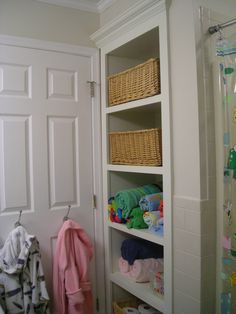 Kid's bathroom. Replaced the linen closet with open shelving for easier access.