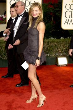 What: Chanel Haute Couture Where: Golden Globe Awards in 2003 Why: If we had legs like Diaz, we'd wear a mini dress to the Golden Globes too.   - HarpersBAZAAR.com