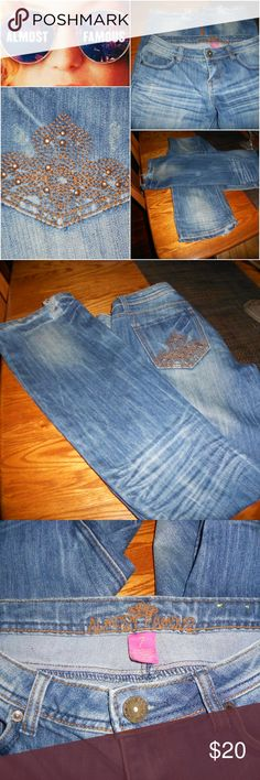 ALMOST FAMOUS BLING WHISKER JEANS SZ 7 YES, YOU WANT THEM...SUPER CUTE WHISKER DISTRESSED JEANS  WITH SOME BLING ON THE POCKET!  DON'T PASS THESE UP....BECAUSE THEY'RE  AWESOME AND....ALMOST FAMOUS! Almost Famous Jeans