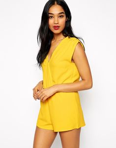 "Playsuit by Rare Lightweight, woven fabric V-neckline and back Wrap styling Flattering, high waist Regular fit - true to size Hand wash 100% Polyester Our model wears a UK 8/EU 36/US 4 and is 175cm/5'9"" tall"