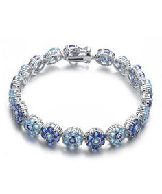 Sale $159.99 reg. $792.00  Silver & Blue Topaz & Sapphire Cubic Zirconia Bracelet by Genevive is perfect for Mothers Day!