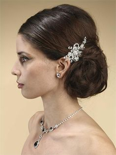 Bridal Hair Accessories Shimmering Crystal Comb Mariell's bridal and special occasion hair acessories collection features this glistening wedding or prom comb that boasts gorgeous faceted Swarovski crystals and rhinestones in a beautiful silver floral motif. This shimmering crystal comb has a bold center flower with dainty rhinestone and crystal sprays.   This lovely comb measures 4 inches wide by 2.5 inches tall to add just the right sparkle to your bridal, prom or bridesmaids hair sty