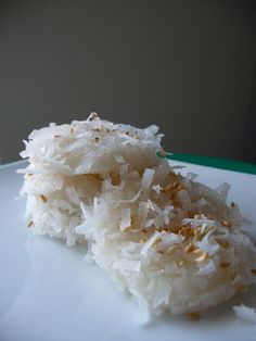 Sticky Rice Dumpling or Palitaw (Philippino food) - with coconut and sesame seed.   [I'm a little freaked out by this - sweet stuff in/on my rice - but it's not with cooked rice, but rather something like what Japanese call mochi.  I'm adventurous and curious what this will taste like]