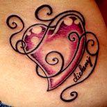 Girl with a swirly heart tattoo