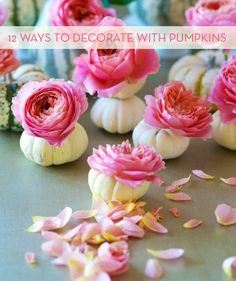 Cute table decorations - pumpkins with peonies. Great for a fall or early winter wedding!