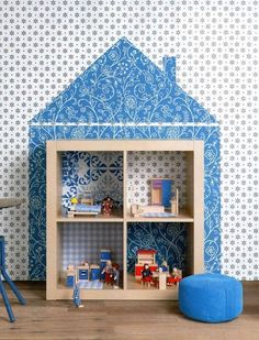 such a good idea -- use an IKEA bookcase as a dollhouse by putting a house shape behind it (doesn't have to be wallpaper). When the kids outgrow it, it can be used for storage.