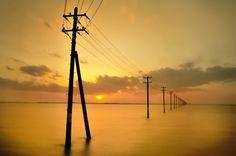 Utility poles in the sea by nao sakaki, via 500px