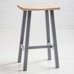 The gorgeous Hudson oak breakfast bar stool is handmade in a solid European white oak, and lightly lime washed before being sealed. The gentle carving of the seat gives a Tibetan look to the piece, which would fit with most styles modern or traditional. This very subtle, country style bar stool is handmade to the highest quality standards.