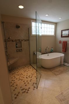 bathroom remodel: large tiled shower and standalone tub (freestanding tub)