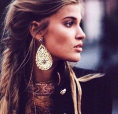 bold brows + twisted back, highlighted hair + bronzer + mascara + nude lips + bold earrings