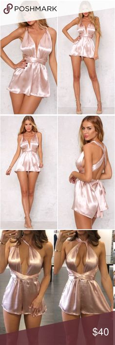 New Blush Satin Romper Gorgeous ultra luxe satin material  Multi wear style front which can be tied in a halter style, a cross shoulder or a wrap up in a knot tie  The shorts have a stretchy waistband and flowy bottom  Pair with over-the-knee boots or strappy heels  This item will ship Thursday Dresses Mini