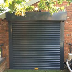 Powder coated electrically operated security roller shutter door fitted to patio doors to a first floor elevated canalside platform