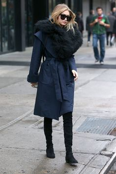 Gigi Hadid street style - black and navy blue combination, navy trench coat, black suede over the knee boots, black fur scarf