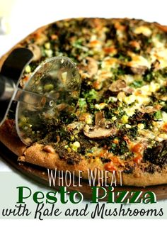 Whole Wheat Pesto Pizza with Kale and Mushrooms on theyoopergirl.com