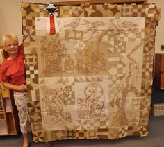 Susie Melchi's award winning Hallowe'en Quilt. It is a Crabapple Hill pattern called Calendula Patterdrips Cottage. All hand colored and hand embroidered. The close up photos are yellow and I am not sure how to eliminate it. Colors on this photo are true.