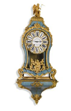 A LOUIS XV GILT-MOUNTED 'CORNE BLEU' BRACKET CLOCK, FRENCH, CIRCA 1745 11½-inch twenty five piece enamel cartouche dial signed J B Pelletie A Paris, similarly signed bell striking movement with numbered outside count wheel and verge escapement, the waisted case with Chronos surmount above foliate mounts to the blue-stained horn veneers; on a conforming bracket Clock 96.5cm. 38in. high; Bracket 34cm. 13½in. high