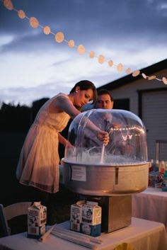 Cotton candy at a wedding - what a great idea! Rent the cotton candy machine here:  http://www.rentrain.com/timerental/product.php?id=53849