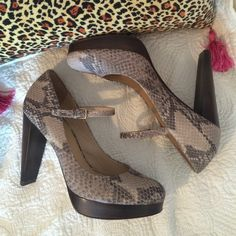 """Exquisite Cole Haan snake mary jane heels. EUC! Hate to part with these beauties, but just don't wear them anymore . Nice neutral snake patterned leather with wood platform and heel. 4 1/2"""" heel, 1"""" platform. Nike air cushioning, very comfortable. High quality shoes. Size 7. Non smoking home. Cole Haan Shoes Heels"""
