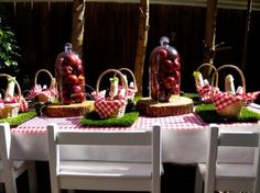 Love the picnic basket place settings and apples under domes!