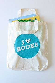Use freezer paper to make a reusable tote for all those library books!  DIY Stencilled Library Book Bag | CBC Parents