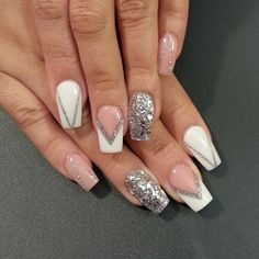 White and silver glitter nail art design forming v-shapes on top of a clear coat base polish.