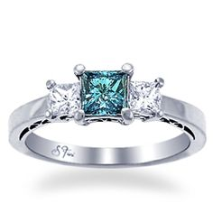 I might just be hinting to what i like here.....because this is the second blue/teal engagement ring i have posted in the last few weeks ;D