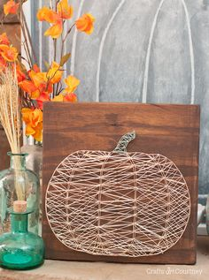I never knew string art was so easy, I did a string art pumpkin to go with my Fall decor.  It's super easy, all I needed was my Silhouette Cameo, nails, and string! Perfect for a girls craft night!