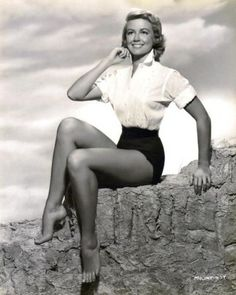 Actress Dorothy Malone. Legs go all the way up.