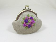 Hand embroidered linen coin purse, embroidered with organza ribbons and beads, free hand.  This floral coin pouch is lined with pink cotton and interfaced with fleece padding and has a bronze colored frame.  No has glue been used, ive sewn on the metal frame for durability.  A perfect gift for mum , aunt or any special lady.  ***One of a kind.***  Made in France.   Frame 8.50 cm (approx 3) Large 12 cm (approx 5) Length 10 cm (approx 4  You can find more of my purses here: https://ww...