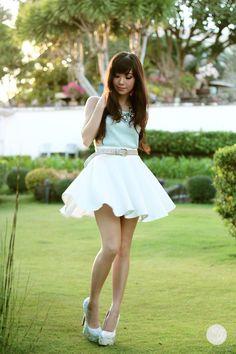 statement necklace, mint tank, beige belt, white circle skirt, sparkly heels