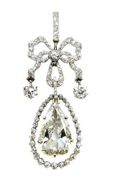Belle Epoque pear shaped diamond pendant, c.1905   , the principal pear cut stone claw set within a graduated swing diamond frame, hung from a millegrain set ribbon tied bow, the ribbon strand ends each suspending a brilliant cut diamond, diamond line suspension loop above