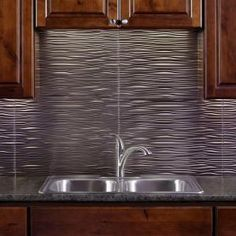 from Home Depot, with a a white kitchen this stainless steel back splash is pretty cool, what do you think? Fasade, 18 in. x 24 in. Waves Brushed Nickel Decorative Wall Tile, B65-29 at The Home Depot - Mobile