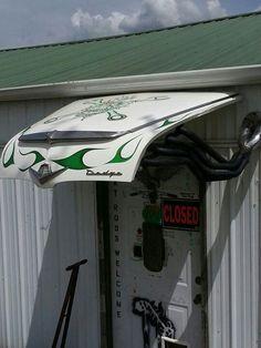 Car hood over entrance door