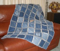 denim quilt - lots of different colour denim with small flowery fabric between - love this idea, cheap and easy to make