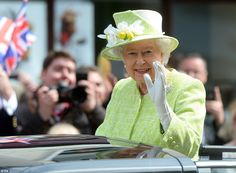 Ready for spring:The Queen was dressed in what was described by Buckingham Palace as a 'spring grass green' wool and silk weave coat and dr...