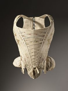 collective-history:    Woman's corset (stays) c. 1730–1740. Silk plain weave with supplementary weft-float patterning, stiffened with baleen.  Los Angeles County Museum of Art