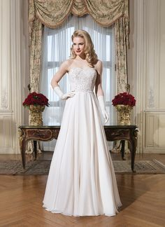 Justin Alexander Wedding Dress Style 8757 Silk chiffon, venice lace, beaded lace A-line dress highlighted with a strapless neckline.